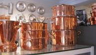 Copper pots and molds at La Cuisine - photo by Jordan Wright
