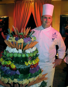 Ritz-Carlton Executive Chef Fredric Chartier with his vegetable tower - photo by Jordan Wright