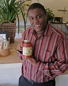 Chef Keaton Hopkins with his pasta sauce - photo by Jordan Wright