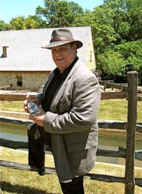 Master Distiller, David Pickerell, poses in front of the distillery - photo by Jordan Wright