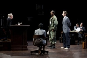 "Judge Omar Noose (Evan Thompson), Carl Lee Hailey (Dion Graham), center, and Jake Brigance (Sebastian Arcelus) in John Grisham's ""A Time to Kill"". Photo Credit Arena Stage"