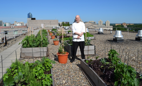 Executive Chef Rafael Gonzalez at the Four Seasons Hotel rooftop garden - Photo Credit Jordan Wright