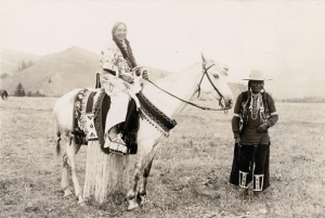 Possibly Chief Eagle of the Salish (at right), with an unidentified woman on horseback, ca. 1905, St. Ignatius, Montana, on the Flathead Reservation.