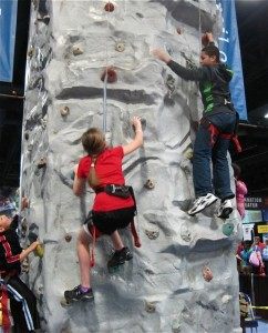 Rock wall climbers at the Travel and Adventure Show in DC - photo credit Jordan Wright