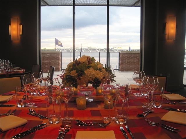 Tablescape with the Wilson Bridge beyond at the Sunset Room at National Harbor - photo credit Jordan Wright
