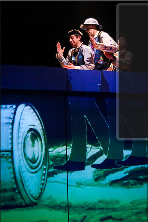 "Pasquale Guiducci, Ben Arden, and Victoria Bertocci in ""A Trip to the Moon."" Projection Design by Jared Mezzocchi. Photo by Johnny Shryock."