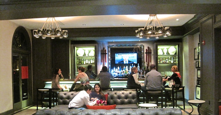 The bar in one of three lounges at the newly redesigned Melrose Hotel - photo credit Jordan Wright