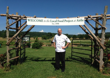 Airlie House Executive Chef Jeff Witte at the entrance to the kitchen gardens - photo credit Jordan Wright