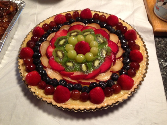 12 ½ inch tart with strawberries, red and green grapes, blueberries, black and red plums and kiwi fruit