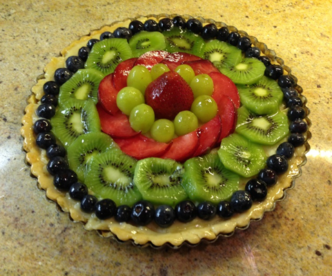 9 ½ inch tart with strawberry, green grapes, red plums, kiwi fruit and blueberries