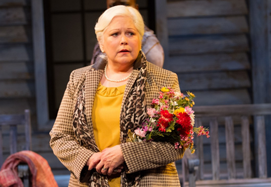 The Woman with Flowers (Florence Lacey) anticipates the return of her estranged daughter in Crossing - Photo by Teresa Wood.