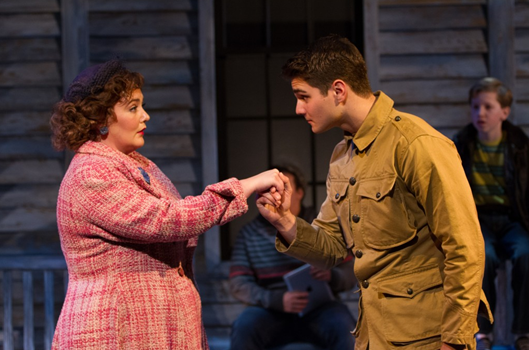 The Woman in Pink (Tracy Lynn Olivera, left) meets the Soldier (Austin Colby) in Crossing - Photo by Teresa Wood.