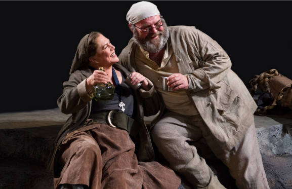 (L to R) Kathleen Turner as Mother Courage and Jack Willis as the Cook in Mother Courage and Her Children - Photo by Teresa Wood