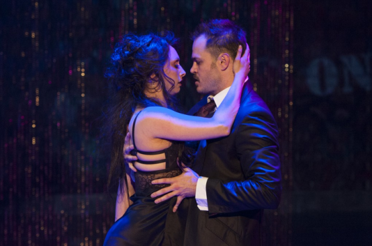 "Jenny (Natascia Diaz) and Macheath (Mitchell Jarvis) dance in ""A Pimp's Tango."" - Photo by Margot Schulman."