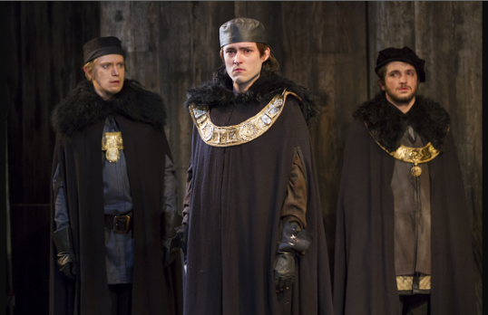 Matthew Amendt as Prince Hal, Patrick Vaill as Lancaster, and Nathan Winkelstein as Gloucester in production of Henry IV, Part 2. Photo by Scott Suchman.