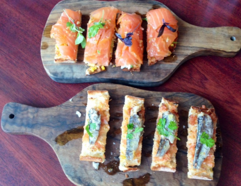 Two types of Pan de Cristal - with smoked salmon or Spanish sardines
