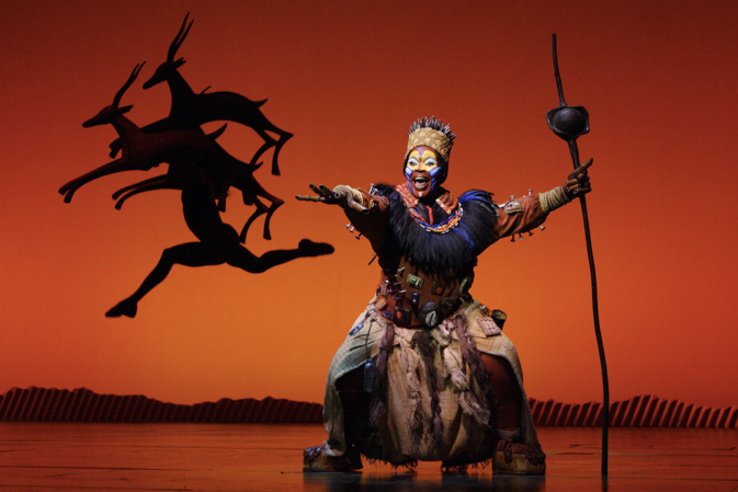 Brown Lindiwe Mkhize as ³Rafiki² in the opening number ³The Circle of Life² from THE LION KING National Tour. Copyright Disney.  Photo Credit  Joan Marcus