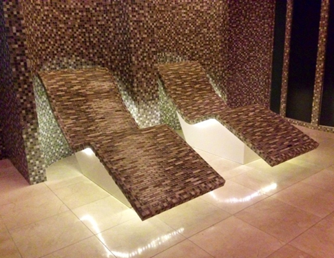 Mosaic tiled warming beds in the spa