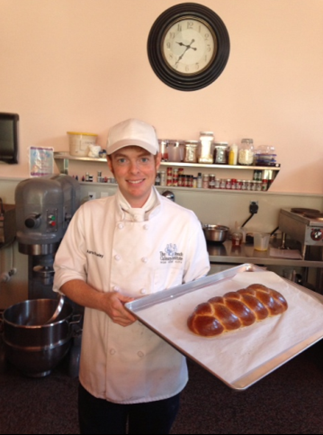 Pastry Chef Adam Powley of Elliot's Baking Company shows off his brioche
