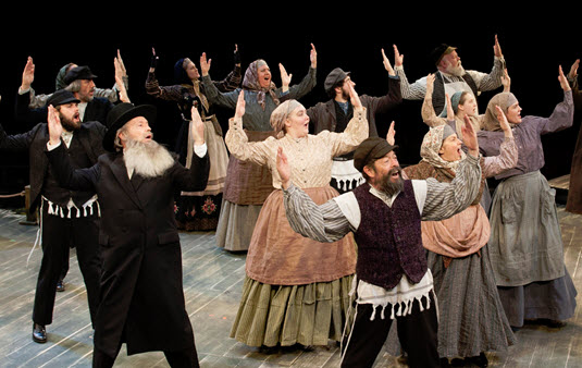 Jonathan Hadary as Tevye and the company of Fiddler on the Roof. Photo by Margot Schulman.