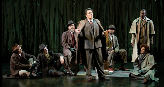 Derek Smith as Jaques (center) with Matthew Schleigh, Nathan Winkelstein, Todd Scofield, Theodore Snead, Timothy D. Stickney and Luis Alberto Gonzalez in the Shakespeare Theatre Company production of William Shakespeare's As You Like It, directed by Michael Attenborough. Photo by Scott Suchman.