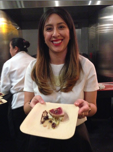 Salamander Resort Public Relations Manager Vanessa Casas serves seared tuna and accompaniments
