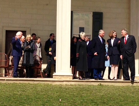 The Prince of Wales talks with Governor McAuliffe (at far right) and Carol Cardou (left of the Governor) - Camilla is seen on the left of the column with Mount Vernon's President Curt Viebranz