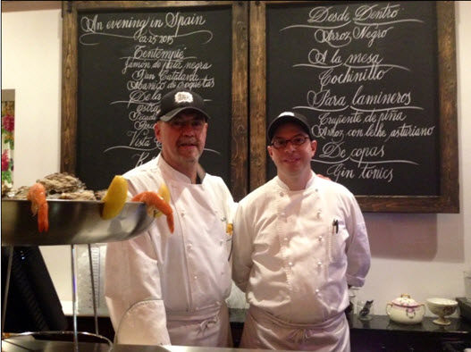 At the raw bar with Executive Chef Josu Zubikarai (left) and oyster shucker