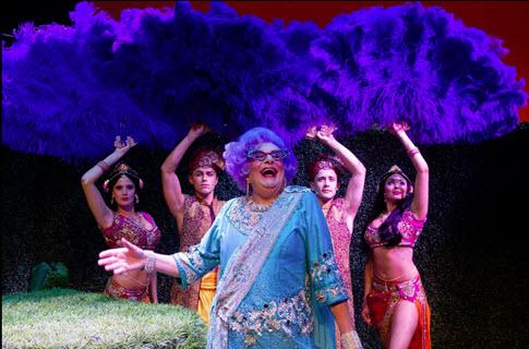 Dame Edna with giant purple ostrich fans - Photo credit Craig Schwartz