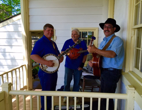 The Cobbler Mountain Grass band tunes up on the porch of Mt. Bleak House