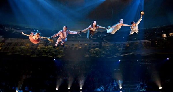 Flight to Neverland Flight (L to R) Tinker Bell (Jessie Sherman), Michael Darling (Scott Weston), Peter Pan (Dan Rosales), Wendy Darling (Sarah Charles), and John Darling (John Alati) in PETER PAN at the Threesixty Theatre. Photo credit: Jeremy Daniel
