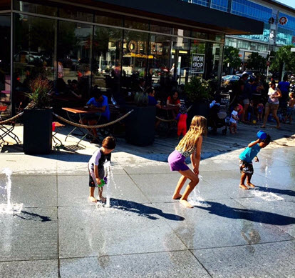 Kids frolic in the fountains outside Mom & Pop's - photo credit Julie Jakopic
