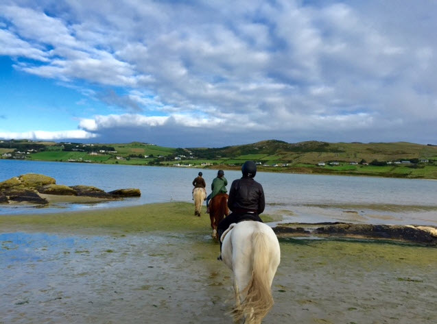 Riders head out to the shoals of Killahoey Strand