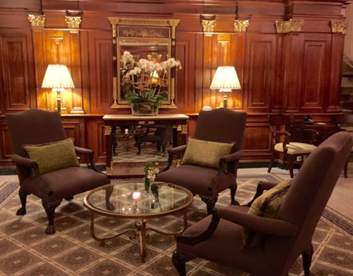 The coffered walls of the hotel's elegant lobby