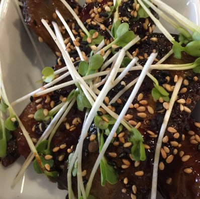 Ribs with sesame seeds and micro greens