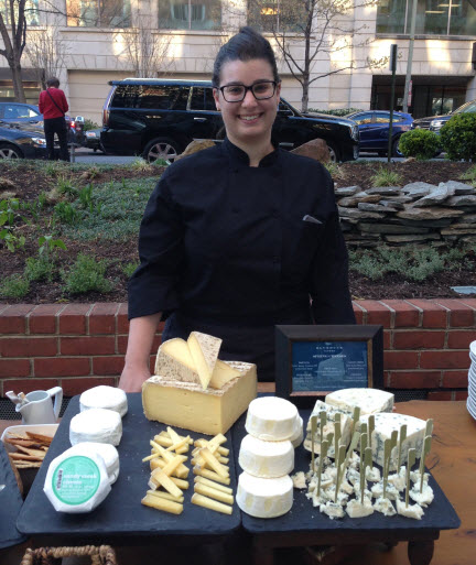 Cheese Specialist Sophie Slesinger displays her wares