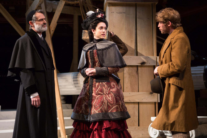 Shylock (Matthew Boston) looks on disapprovingly as Lorenzo (William Vaughan) tries to steal a kind word with Jessica (Dani Stoller) - Photo by Teresa Wood