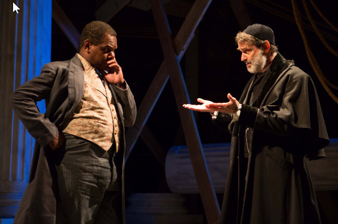 Shylock (Matthew Boston, right) works out the terms of his loan with Antoine (Craig Wallace) in Aaron Posner's ~ Photo by Teresa Wood.