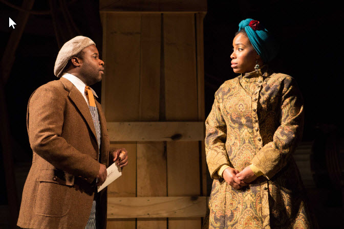 Lancelot (Akeem Davis) receives a most important letter from Nessa (Celeste Jones) ~ Photo by Teresa Wood.