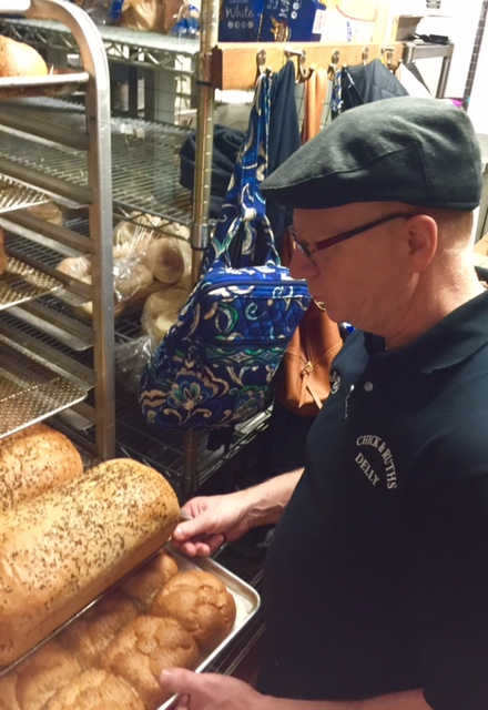 Owner Ted Levitt inspects the morning's bread. All pastries, breads, bagels, pies and cookies are baked on premises