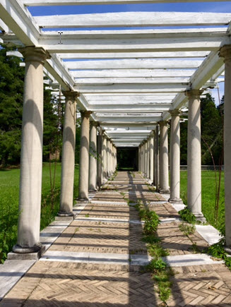 The expansive pergola depicted in the Tiffany window has fallen into disrepair