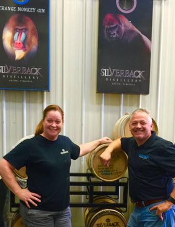 Christine and Denver Riggleman beside casks of their aged bourbon