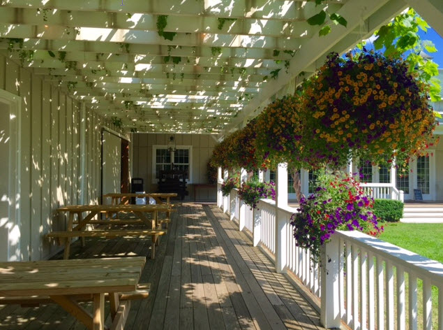 The flower filled pergola greets visitors to Veritas Winery