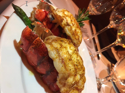 Twin Maine lobster tails at Ocean Prime are served with asparagus