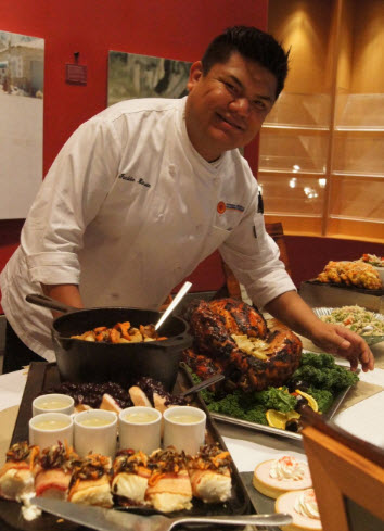 Mitsitam Executive Chef, Freddie Bitsoie shows off some of his Thanksgiving dishes - photo courtesy NMAI