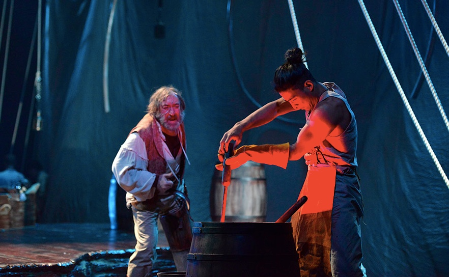L to R) Christopher Donahue as Captain Ahab and Javen Ulambayar as Mungun in Moby Dick. Photo by Greg Mooney.