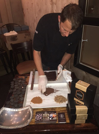 Tim Gearhart hand rolls the whiskey truffles