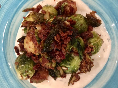 Brussels sprouts with lemon, garlic yogurt and bacon at Ambar