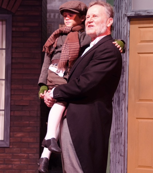 Tony Gilbert (Scrooge) and Josh Gordon (Tiny Tim) - Photo credit Doug Olmstead