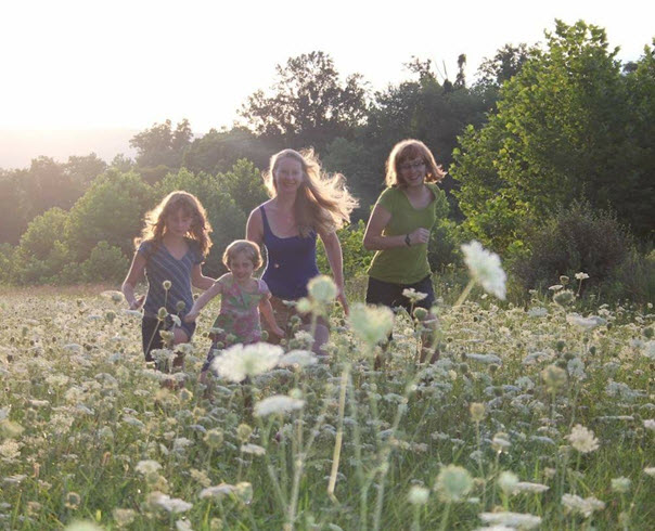 Liz Reitzig with three of her five children in the chamomile fields